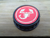 Picture of fuel filler cap with ABARTH emblem, red