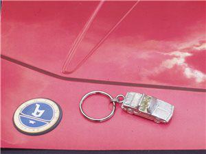 Afbeeldingen van sleutelhanger X 1/9 in tin